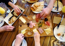 People Sharing A Charcuterie Platter