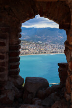 View Of The Mediterranean Sea From The Arch In The Wall Of Old Fortress