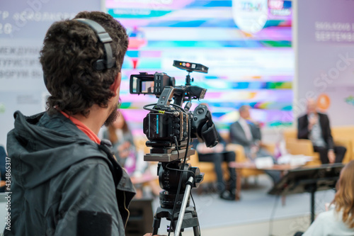 Cameraman shooting video and broadcasting conference #434865317