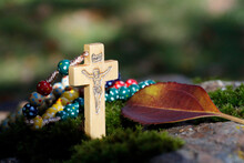 Catholic Church. Wooden Rosary With Autum Leaf.