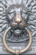Vertical Shot Of A Metal Lion Head Door Knocker In Cologne, Germany
