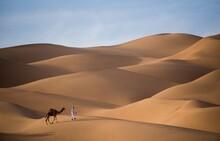 Full Length Of Man With Camel In Desert
