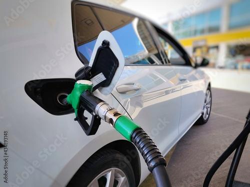 Car refueling in filling station. Gasoline and diesel pump. Fototapeta