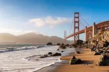 Golden Gate Bridge View From California Beach, Ocean Wave, Sand And Rocks In Marshall's Beach, San Francisco, California