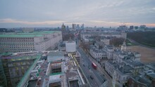 Epic Aerial Drone Wide Angle View Tracking Forwards Over Whitehall Looking Towards Big Ben And Parliament At Sunset With London Red Buses On Road Below