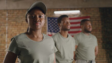 Black Military Woman Standing Near Male Squadmates