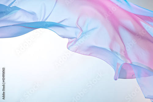 Smooth elegant colorful transparent cloth separated on white background. Texture of flying fabric. #434906163