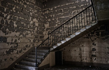 Stairs In A Abandoned Interior Architecture Of Old Building.