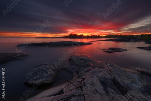 Obraz na plátne Rocky shore of the northern lake at dawn, lake Ladoga