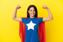 Woman Isolated On Yellow Background In Superhero Costume And Doing Strong Gesture
