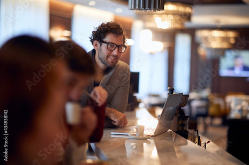 young handsome businessman working from a bar, drinking coffee Fototapet