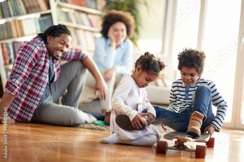 A young cheerful family having a good time at home together. Family, together, love, playtime #434938345