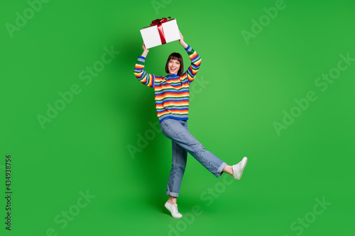 Fotografiet Full length photo of lucky funny young woman wear striped sweater smiling rising