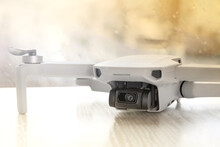 Gray Mini Quadcopter On The Background Of The Window
