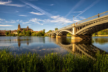 Salamanca Cathedral Reflected On Tormes River And Iron Bridge Castille