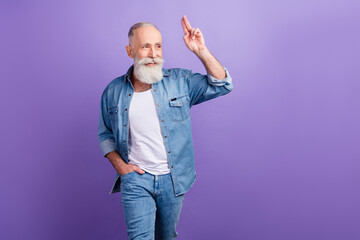 Photo of elderly man happy positive smile show fingers hello salute look empty space isolated over purple color background