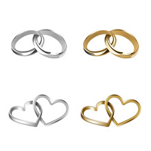 Set Of Gold And Silver Wedding Rings. Heart And Round Shaped Rings. Interlocking Rings