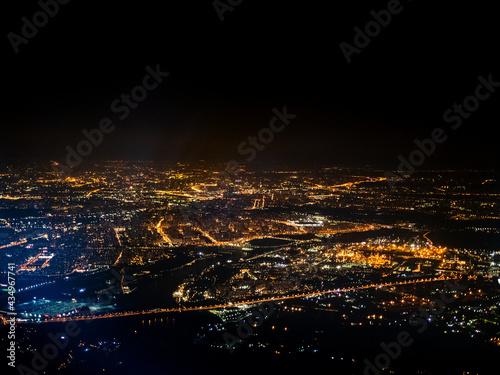 Obraz na plátně aerial view illuminated suburbs of city at night