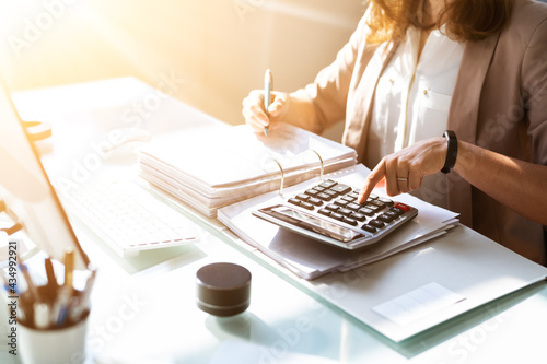 Accountant Calculating Budget And Tax