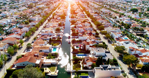 Aerial view over the houses of a Surbubian community under the sunlight Fototapeta