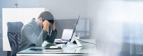 Unhappy Depressed Employee With Stress Using Computer