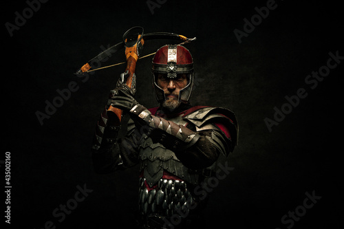 Valokuvatapetti Portrait of a medieval fighter holding a crossbow in his hands