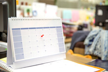 Calendar, Close-up Red Pin On Blank Desk Calendar And Office Equipment Concept Of Events Planner Or Busy Or Planning For Business Meeting Or Travel And Appointment Reminders Concepts.