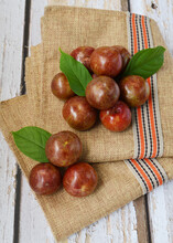 Shiny Delicious Fresh Harvested Asian Plums Under The Sun