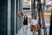 Young Woman With Shopping Bags. Happy Woman With Shopping Bags Enjoying In Shopping. Lifestyle Concept. Fashion Woman With Shopping Bags Walking On Street.