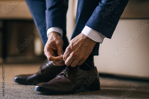 businessman clothes shoes, man getting ready for work, groom in the morning befo Fotobehang