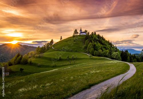 Canvas-taulu Sveti Jakob hill with a church on top, Central Slovenia region