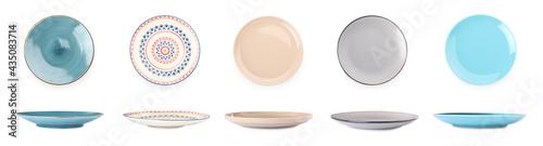 Fotografiet Set with empty ceramic plates on white background. Banner design