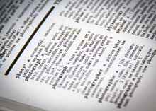 A Close-up Of The Definition Of Photography In A Dictionary And Thesaurus