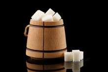 Many Pieces Of White Sugar In A Wooden Barrel