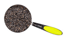 Top View Of Niger Seeds In Measuring Cup Cutout