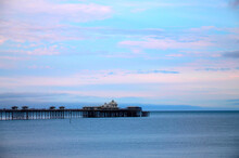 Seaside Landscape With Pier, England, UK. Minimalistic Seaside Landscape With The Pier, Sunset Or Sunrise In Pastel Colors.