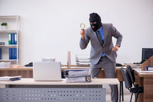 Young Male Employee In Industrial Espionage Concept