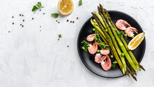 Healthy Eating Salad Baked Asparagus With Grilled Shrimps, Green Peas And Lemon. Keto Breakfast. Banner, Menu Recipe Place For Text, Top View