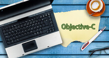 Objective-c Programming Language. Paper Width Word Objective-c And Laptop