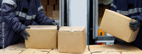 Obraz na plátně Picking up package boxes in the loading area of cold storage warehouse prepare t