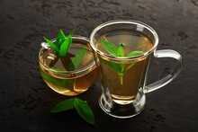 Large And Small Glass Cups Of Drink With Mint Leaves