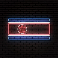 Neon Sign In The Form Of The Flag Of North Korea. Against The Background Of A Brick Wall With A Shadow. For The Design Of Tourist Or Patriotic Themes.