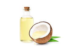 Coconut Oil Dripping From Coconut Cut In Half With Bottle  Isolated On White Background.