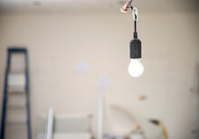 Temporary Light  At Construction Site,  Hanging From The Ceiling. Construction Site Background