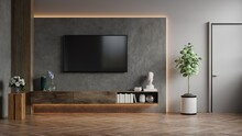 Mockup A TV Wall Mounted In A Dark Room With Concrete Wall.