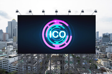 ICO hologram icon on billboard over panorama city view of Bangkok at day time. The hub of blockchain projects in Southeast Asia. The concept of initial coin offering, decentralized finance