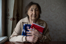 Very Old Woman With Flag Of United States Of America.