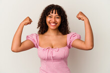 Young Mixed Race Woman Isolated On White Background Showing Strength Gesture With Arms, Symbol Of Feminine Power