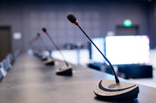 Close-up Of Microphones In An Empty Meeting Room At A Press Conference.