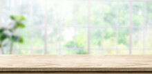 Wooden Table Background With Blur Window See Through Garden At Home.Mockup Banner Space For Product Display For Advetising At Online Media